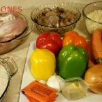 Arroz sepultado (Arroz con pollo, camarones, chorizo y queso rayado )