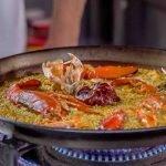 Paella de bogavante, arroz seco de marisco